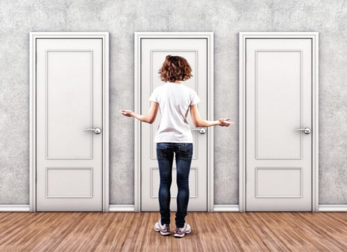 Woman in front of three closed doors